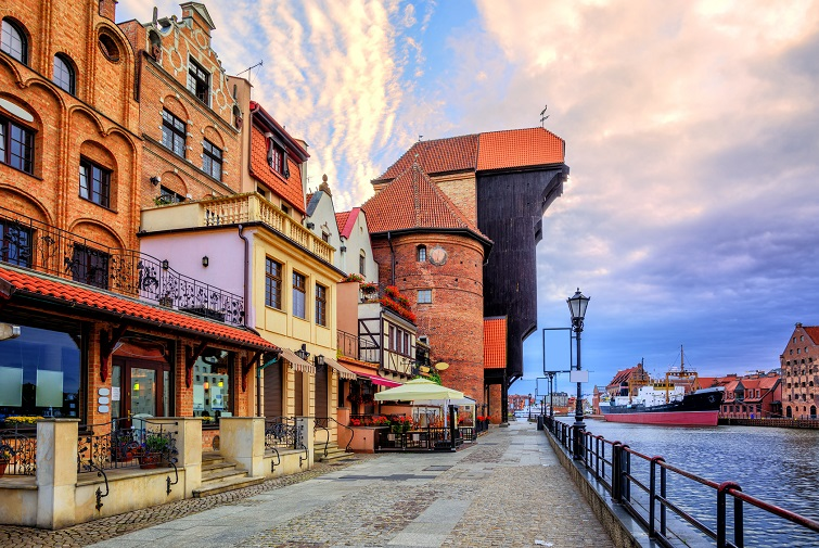 Riverside promenade in the old town of Gdansk with prominent Zuraw Crane, Baltic Sea, Poland